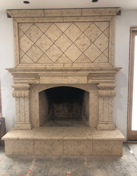 lattice and pillar fancy fireplace made out of limestone