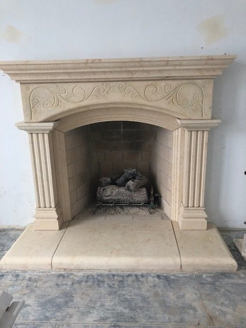 simply decorated concrete and brick fireplace