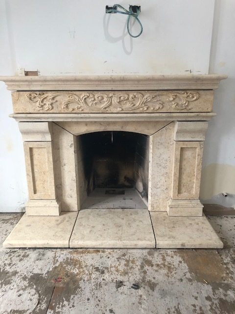 very intricate multi stone fireplace