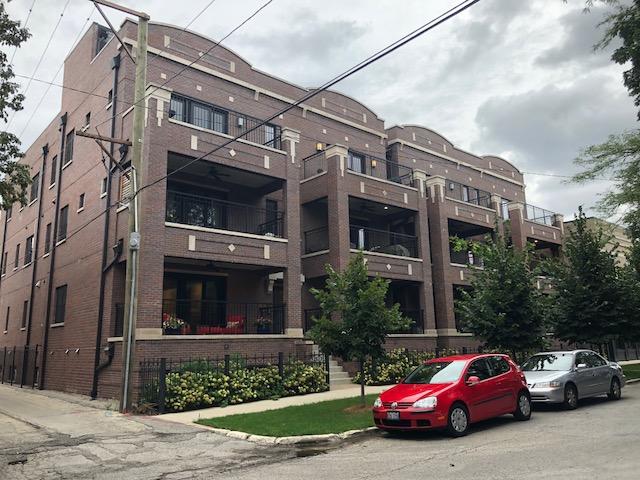 dark brick multi unit apartment building in downtown chicago