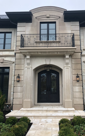 front door entrance with a balcony in a mansion in suburban chicago