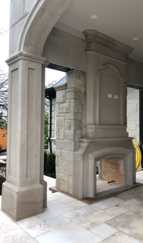 outdoor fireplace in a patio in a mansion